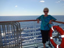 Mom leaning on railing.