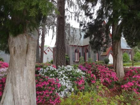 Church seen through the trees.