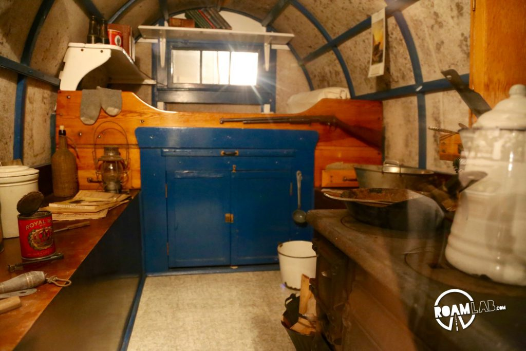 Interior of a 1915 sheep wagon. It's fascinating to see how similar the layout is to modern day truck bed campers. Both include a bed, kitchen area and storage in similar layout just a cast iron stove makes for a much heavier load.