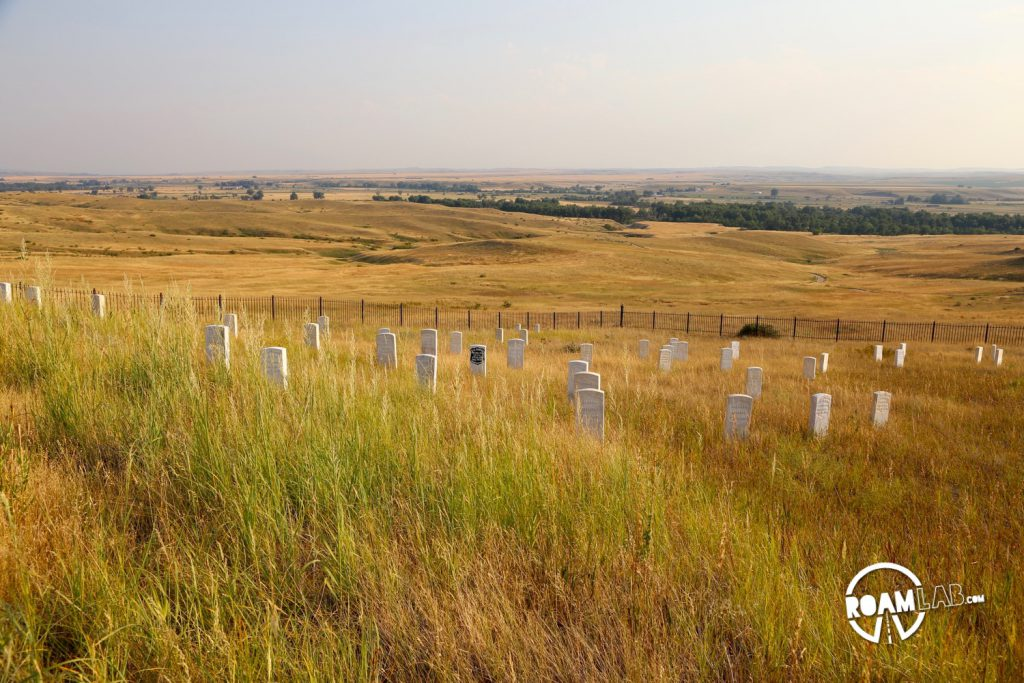 A dense collection of gravestones marking the locations where men fell in Custer's last stand. The black stone marks Custer's final resting place.
