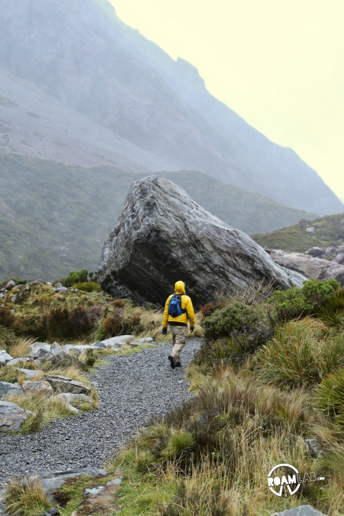Contending against gale force winds to see a glacier on the Hooker's Valley Track along the Southern Alps in Aoraki/Mount Cook National Park.