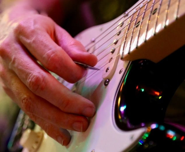 Strumming on the electric guitar