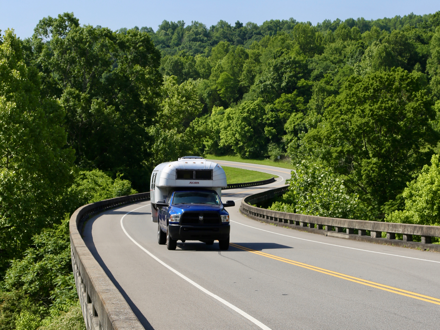 Aluminum truck camper on a blue truck on the Natchez Trace