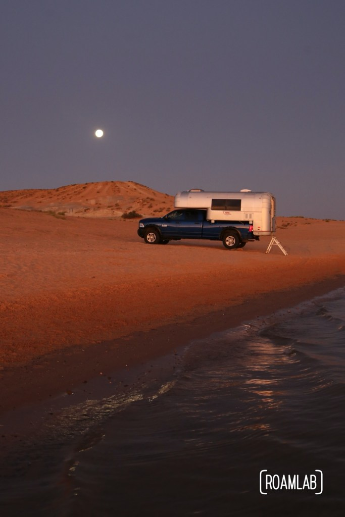Beach camping along Lake Powel for off-road vehicles at Lone Rock Campground in Glen Canyon National Recreation Area just north of Page, Arizona.