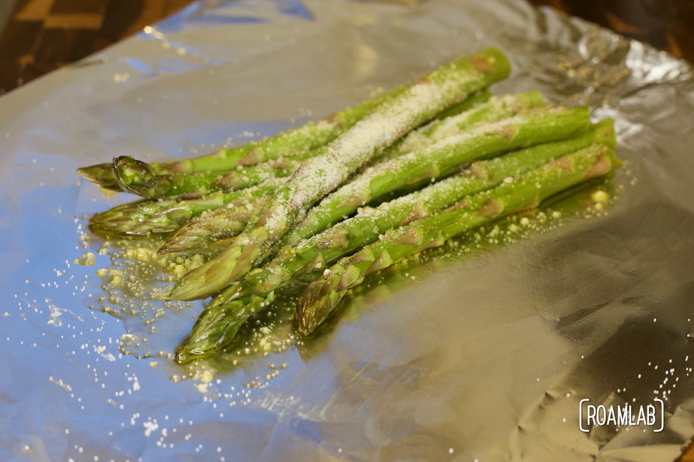 Savor a bundle of tasty vegetable spears on your next camping trip with this tin foil parmesan asparagus campfire cooking side dish recipe.