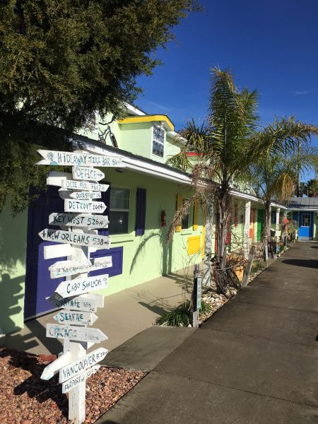 The colorful motel and sign at Low Key Hideaway RV Resort on Cedar Key in Florida