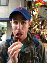 Matt eating an octopus ball - would you eat one?