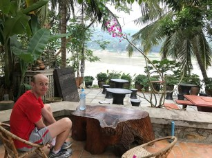 Matt sitting across the Mekong.