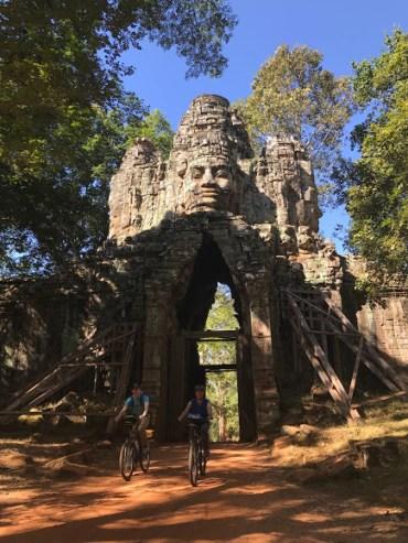 Biking through one of the 5 gates of Angkor Thom.
