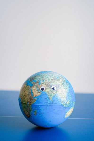 sphere shaped miniature of earth with googly eyes, world economies will depend on the relationship between china and the US