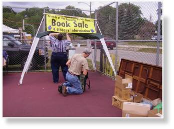 A photo of Library booth going up at the Roanoke Fall Festival