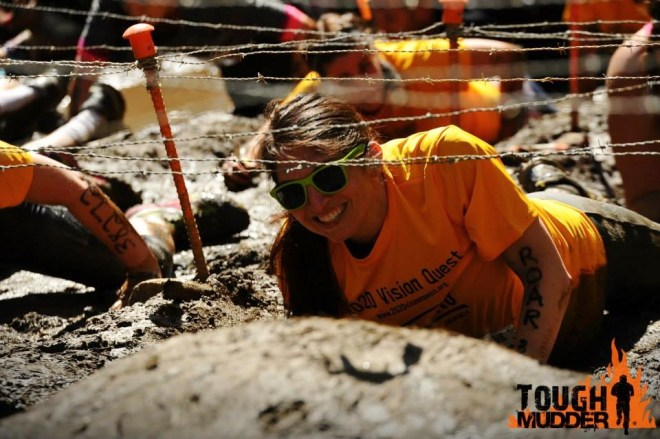Barbed wire is way more fun than under water obstacles! Roar! Photo Credit: gamefacemedia.com