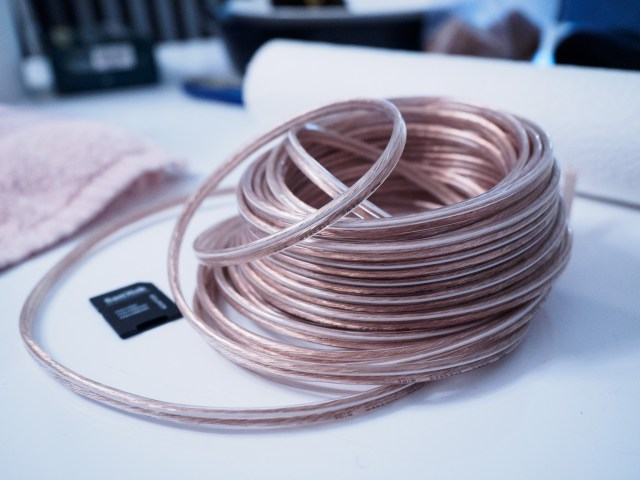 100ft of completely pedestrian 14AWG speaker wire.
