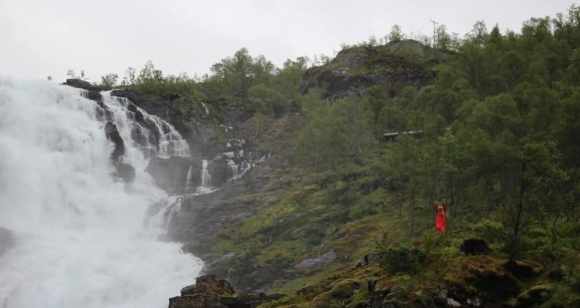 Kjosfossen waterfall dancing woman Norway in a Nutshell