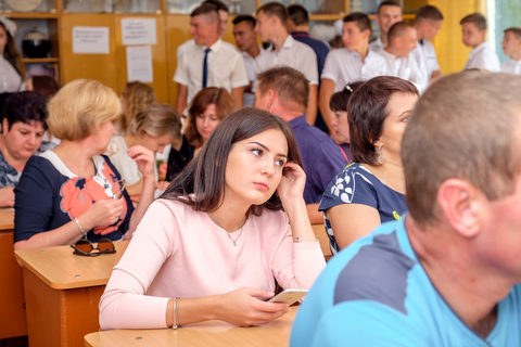Parents and pupils in class on school meeting