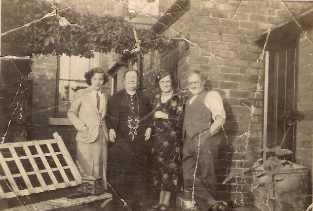 L-R: My great-aunt and Harry England's wife Ethel May England (née Buxton, no relation), my great-great-grandmother Mary Ann Bestwick (formerly Ling, formerly Buxton, née Hall), my great-grandmother Maud England (née Ling), and my great-grandfather Tom England, c. 1935.