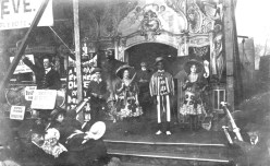 Detail of show stand featuring Ben Hobson (far left), c. 1907. Courtesy of the National Fairground Archive.