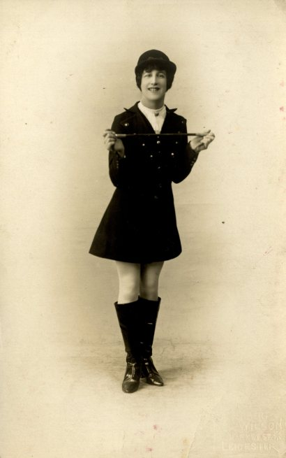 Unidentified female Music Hall performer in jockey outfit, c. 1905.