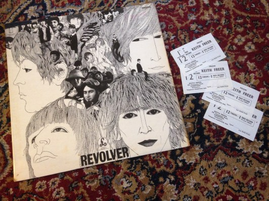 My uncle's copy of Revolver by the Beatles with the four record tokens found inside the sleeve.