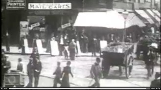 Screenshot from 'Leeds Street Scenes' (1898) showing a mail carts shop sign near the top left (via Yorkshire Film Archive).