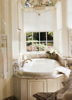 Windows on three sides of the bathtub niche make for a brightly lit bathing experience. The angled area was built around the tub for a snug fit with no wasted space.