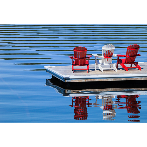 Muskoka chairs, Canadian flag, lake
