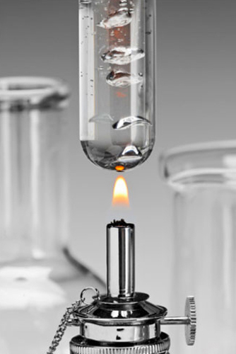 lab glassware, alcohol flame, boiling water in test tube