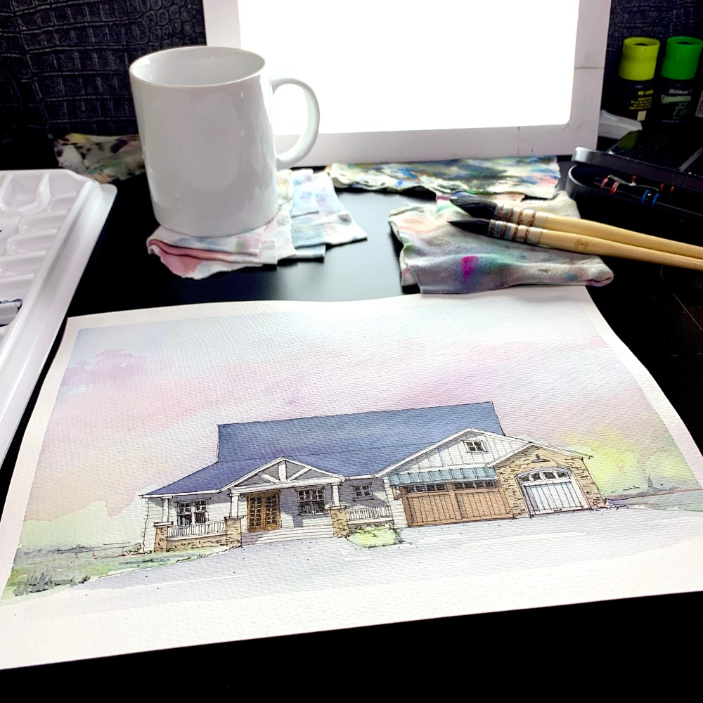 Designing a Farmhouse - Watercolor Sketch over desk with pencils and a Coffe mug