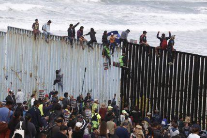 climbing border wall