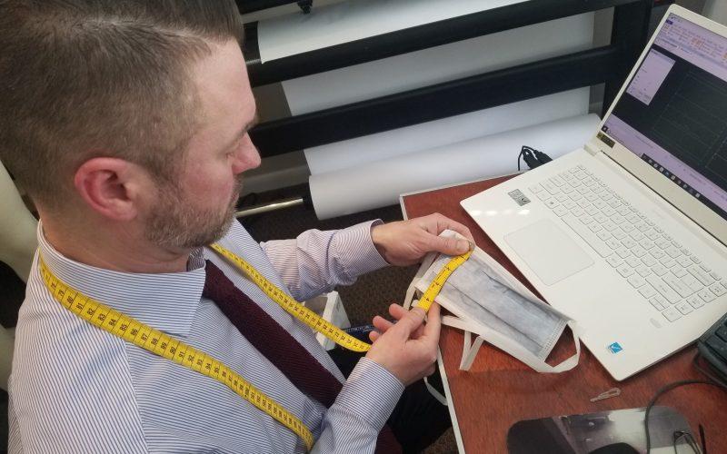 Jeffery measuring a sample face mask
