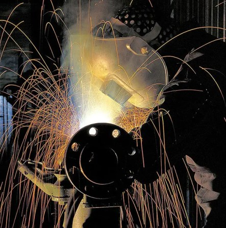 Corporate industrial photography of a welder