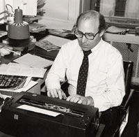 Robert Liebman typing on a typewriter