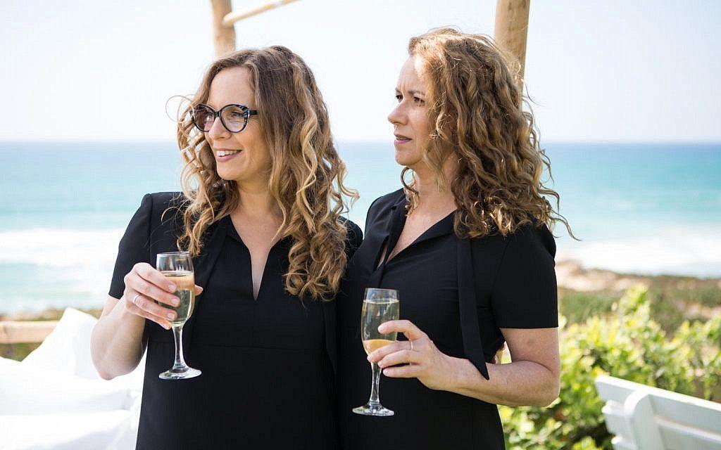 Israeli pastry influencer Sharon Heinrich, left, with wife Gali Hadari at a wedding party in Beit Yanai, Israel, 2016. (Nir Slakman)