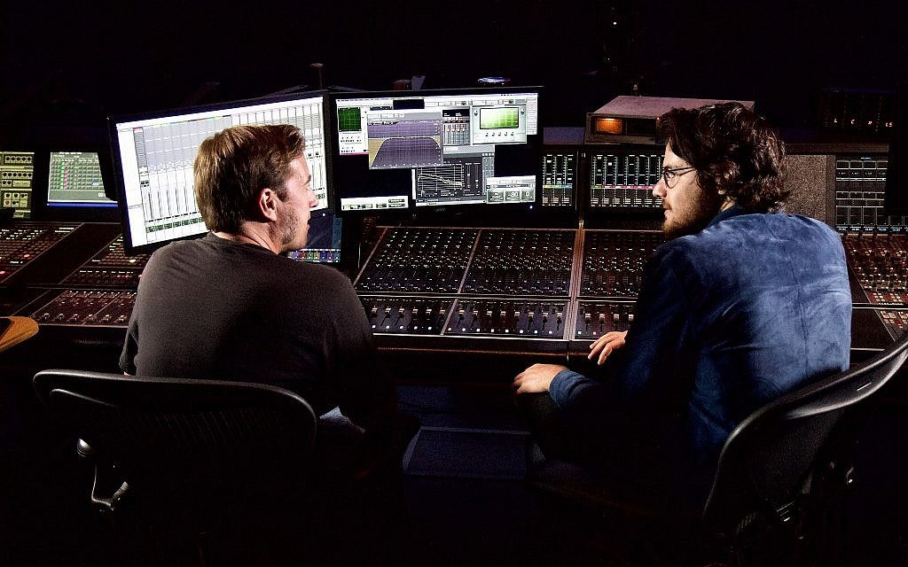 Film director Daniel Roher, right, at a digital post-production studio in Toronto, Ontario, August 29, 2019. (Etye Sarner)