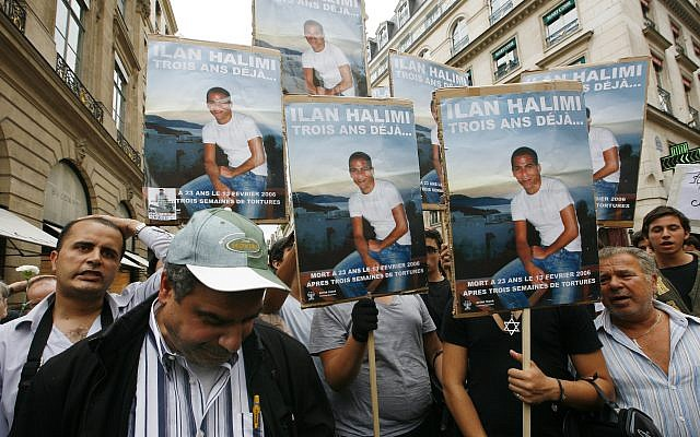 Demonstrators hold photographs of Ilan Halimi at the end of the two-month trial of a Paris gang who in 2006 kidnapped, tortured and killed Halimi, a young French Jew, Thursday, November 2, 2017. (AP Photo/Jacques Brinon, File)