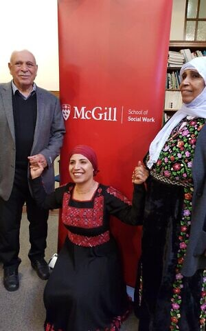 Amal Elsana-Alh'jooj, center, with her parents at her PhD graduation at McGill University in Montreal, 2017.