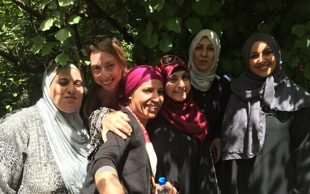 Amal Elsana-Alh'jooj, center-left, with women volunteers at the Waqe3 community center in Jordan.