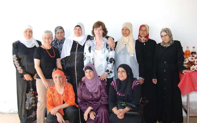 Cherie Blair, wife of former British prime minister Tony Blair, visits the Bedouin village of Hura in 2007. She came to learn about the catering program for single mothers that Amal Elsana-Alh'jooj, pictured front left, helped create.