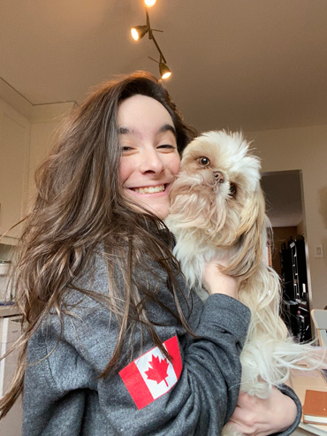 Hannah Alper at home in Toronto with Charlie, one of her family's two Shih Tzus, in March 2020.