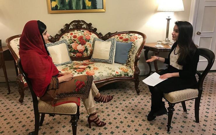 Hannah Alper, right, interviews Nobel laureate Malala Yousafzai in Ottawa, April 12, 2017.