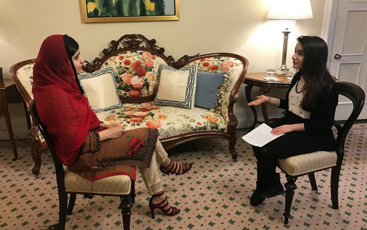 Hannah Alper, right, interviews Nobel laureate Malala Yousafzai in Ottawa, April 12, 2017.