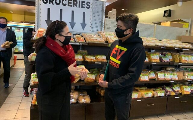 Then-candidate Ya'ara Saks meets a small business owner ahead of the by-election in which she ran to represent the York Centre district in Canada's Parliament, October 19, 2020.