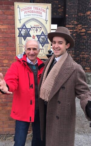 Robert Rotenberg, left, with an actor on the set of 'Murdoch Mysteries,' a television series for which he wrote two episodes, Hamilton, Ontario, November 2017.