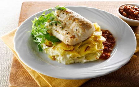 Grilled Hake with Garlic Potatoes and Sun-Dried Tomato Dressing