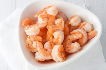 fresh cooked shrimp in white bowl