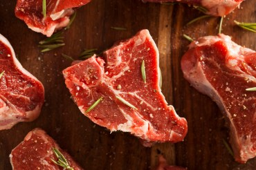 Raw Red Lamb Chops with Salt and Pepper Seasoning