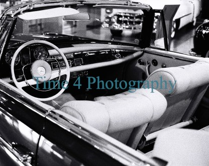1963 convertible Mercedes Benz 300 SE , picture showing the inside and dashboard of that classic , black and white picture.