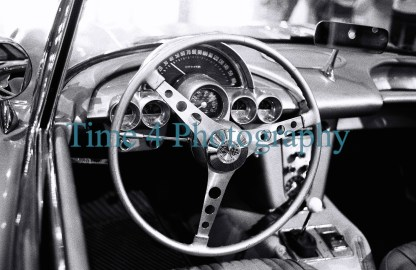 1958 Chevrolet Corvette at a car show, view of the dasboard, black and white picture