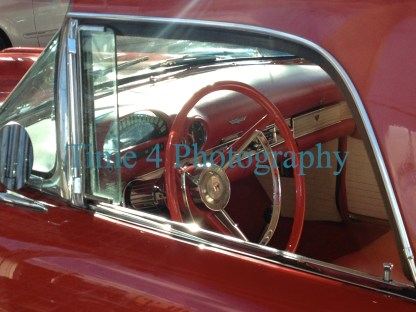 Dashboard view of a 1956 red Ford Thunderbird