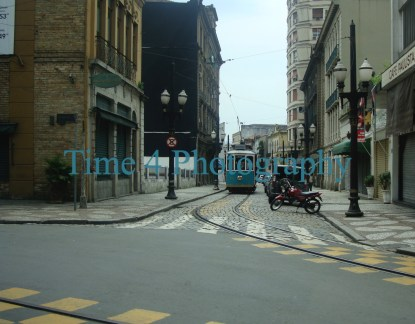 In the downtown area of Santos, Brasil,there is still an old streetcar line enjoyed by tourists on weekends. The streetcar is at the far end of the street.